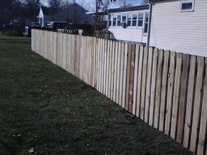 aging dividing wood fence